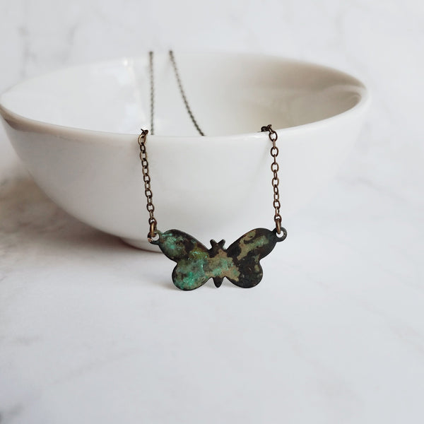 Small Butterfly Necklace in a brass verdigris patina - petite minimalist style in aqua blue green hues on simple delicate bronze chain - Constant Baubling