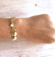 Skull Bracelet - matte gold tiny little cluster fringe of thin flat cut out little skeleton faces - cha cha adjustable chain & lobster clasp - Constant Baubling