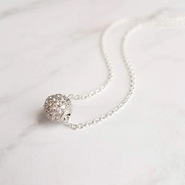 Silver Crystal Ball Necklace - round sphere of glittering faux diamond pave bead strung on delicate thin chain - tiny globe/slider pendant - Constant Baubling