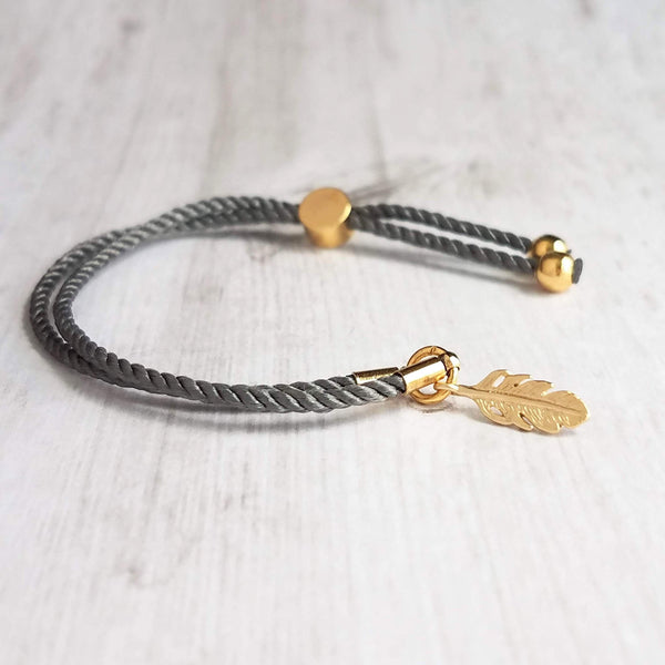 Gold Feather Bracelet - grey silk style twisted rope cord & delicate little charm - adjustable /one size fits most - gray layering stack - Constant Baubling
