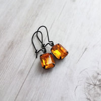 Halloween Earrings - orange glass faceted rectangle in vintage black setting - amber topaz color rhinestone - latching black kidney ear hook - Constant Baubling