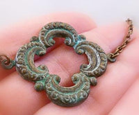 Clover Necklace - green blue verdigris patina on medium antique bronze/brass chain - large lucky 4 leaf lobe pendant w/ ornate detail - Constant Baubling