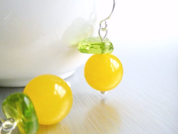 Juicy Orange Earrings - Fresh Squeezed Fruit for your Ears - small round frosted glass ball with glass leaf on a tiny silver plated hook - Constant Baubling