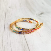 Large Gold Hoops Earrings w/ rainbow crystal rhinestone accent, thin post style 1.5 inch diameter, happy sparkling LGBT+ pride jewelry