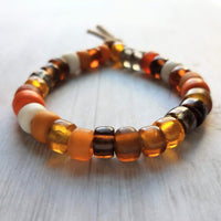 Autumn Colors Bracelet - solid glass big pony crow roller beads on tan suede style adjustable tie cord, VSCO girl, orange brown amber