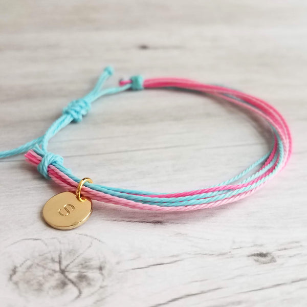 Friendship Bracelet - multicolor / rainbow strands - adjustable w/ letter initial disk in gold or silver - 9 string thin waxed cotton