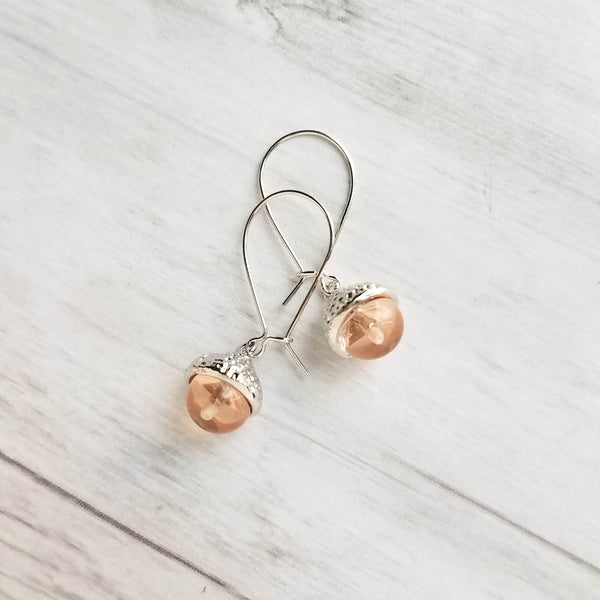 Glass Acorn Earrings - small pale peach nude glass nut in silver rhodium plated cap - simple autumn tree seed - petite little fall gift