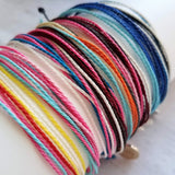 Friendship Bracelet - multicolor / rainbow strands - adjustable w/ letter initial disk in gold or silver - 9 string thin waxed cotton - Constant Baubling