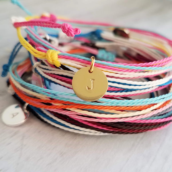 Cotton String Bracelet - multicolor / rainbow strands - adjustable w/ letter initial disk in gold or silver - thin friendship stacking bracelet - Constant Baubling