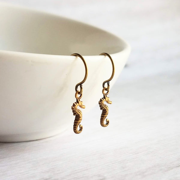 Little Seahorse Earrings - tiny antique brass / bronze sea animal charms with an oxidized finish - mini beach sea ocean critter - Constant Baubling