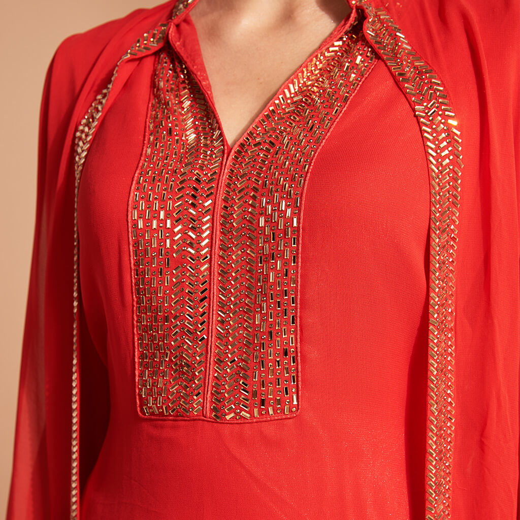 Red outfit with bronze gold sequins