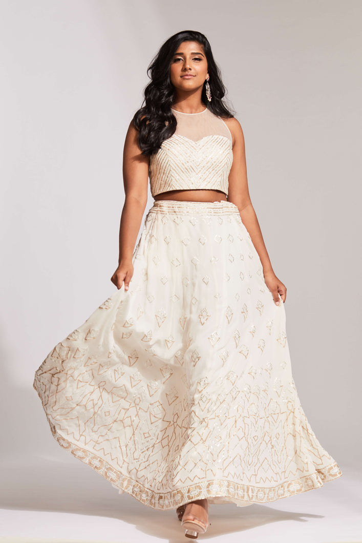 Cream lehenga with gota patti work