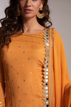 Orange pant with orange kurta top close-up