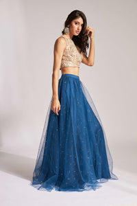 Lehenga with blue sequin skirt and nude halter-style mirror work blouse