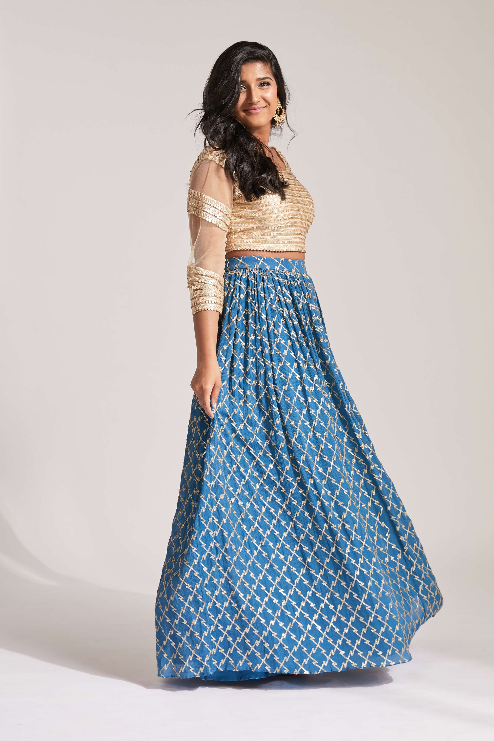Lehenga with blue and gold skirt and gold sequin 3/4 sleeve blouse