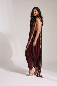 Dhoti pant outfit with attached drape and nude mirror work halter-style blouse