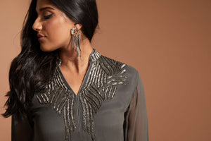 Silver palazzo pant outfit with long kurta top and subtle beading at the color, back, and wrist