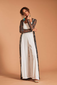 Black net cape with palazzo pants