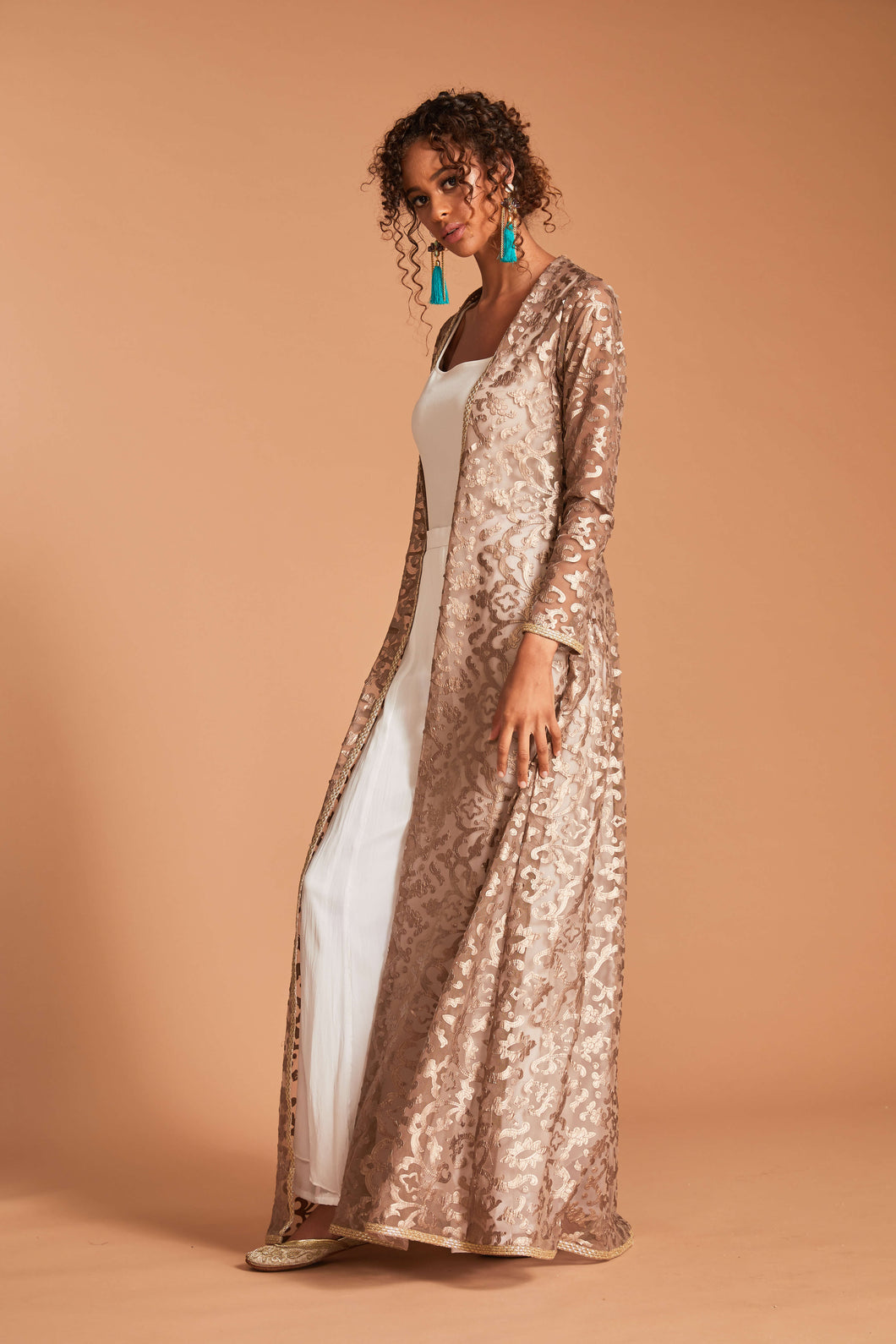 Brown cape with leather cutout embroidery and palazzo pants