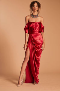 Off-the-shoulder pleated lido satin gown in a daring metallic red with a high slit