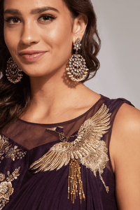 Model in gown with gold and pearl earrings