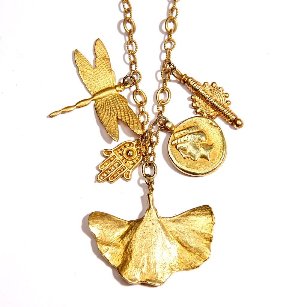 Franciska Journey Necklace 24K Gold Plated With Gingko Leaf, Hamsa Hand,Indian Swirl,Dragon fly.