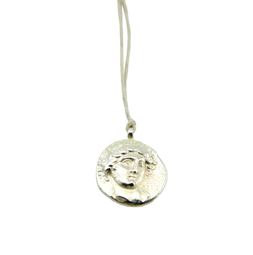 God of Sun Silver Coin on Natural Hemp