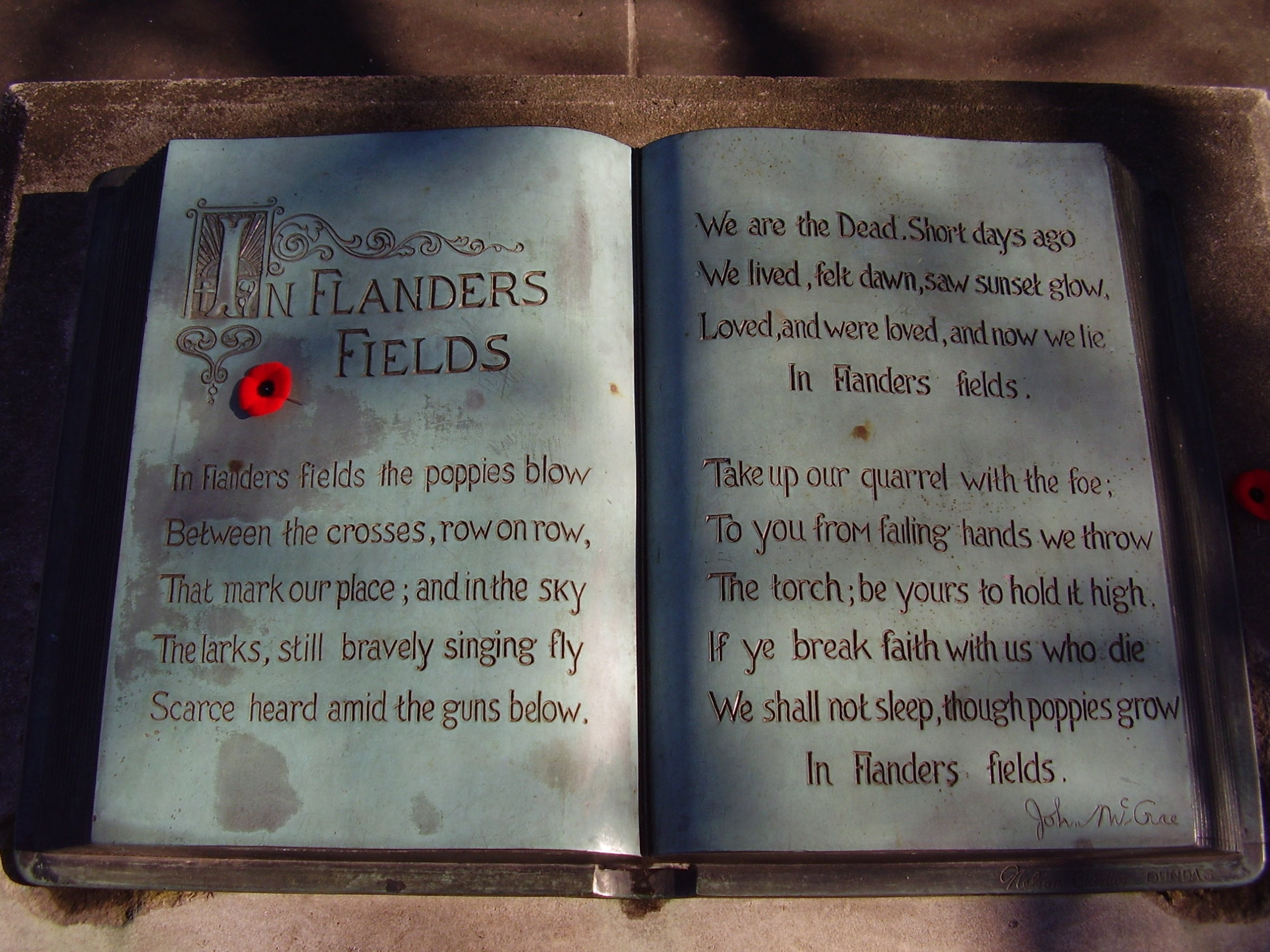 Inscription of In Flanders Fields at the John McCrae memorial