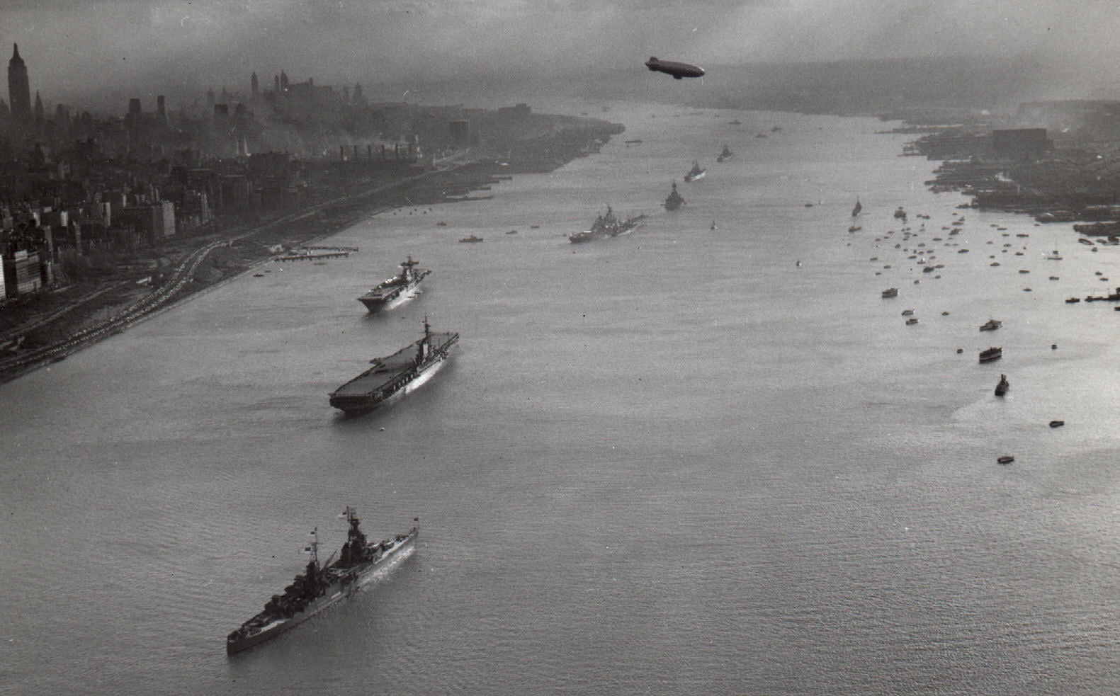 Ships anchored on the Hudson River north above New York City for the 1945 Navy Day at the victorious end of World War II.