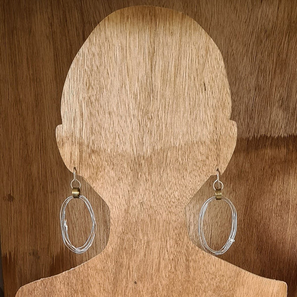 Silver hoops with brass cuff.