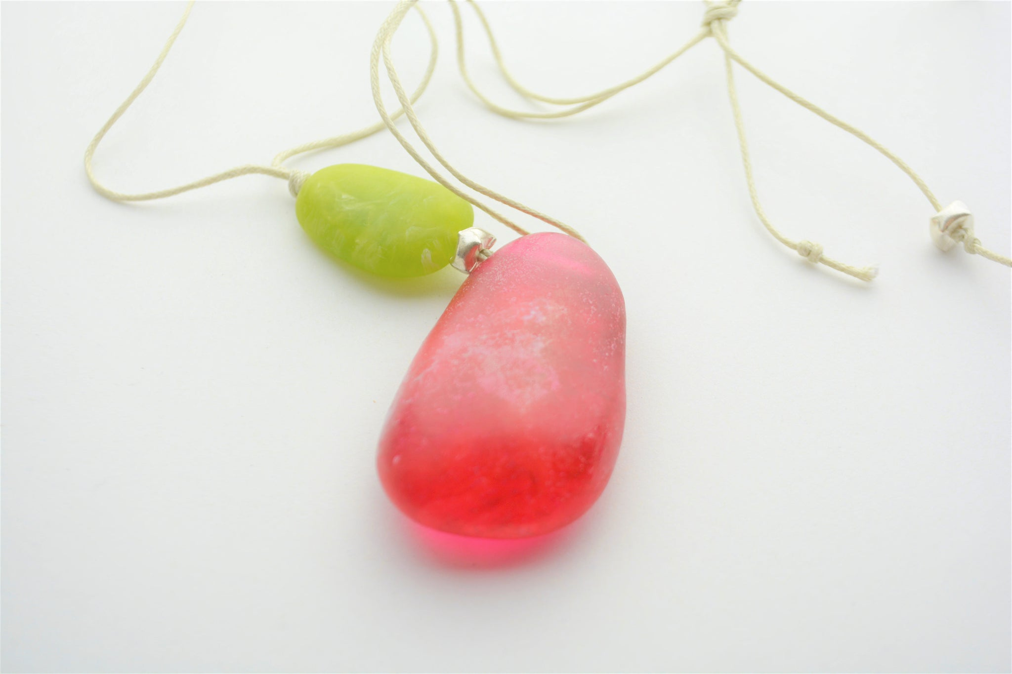 Contemporary handmade adjustable pink and lime resin pendant