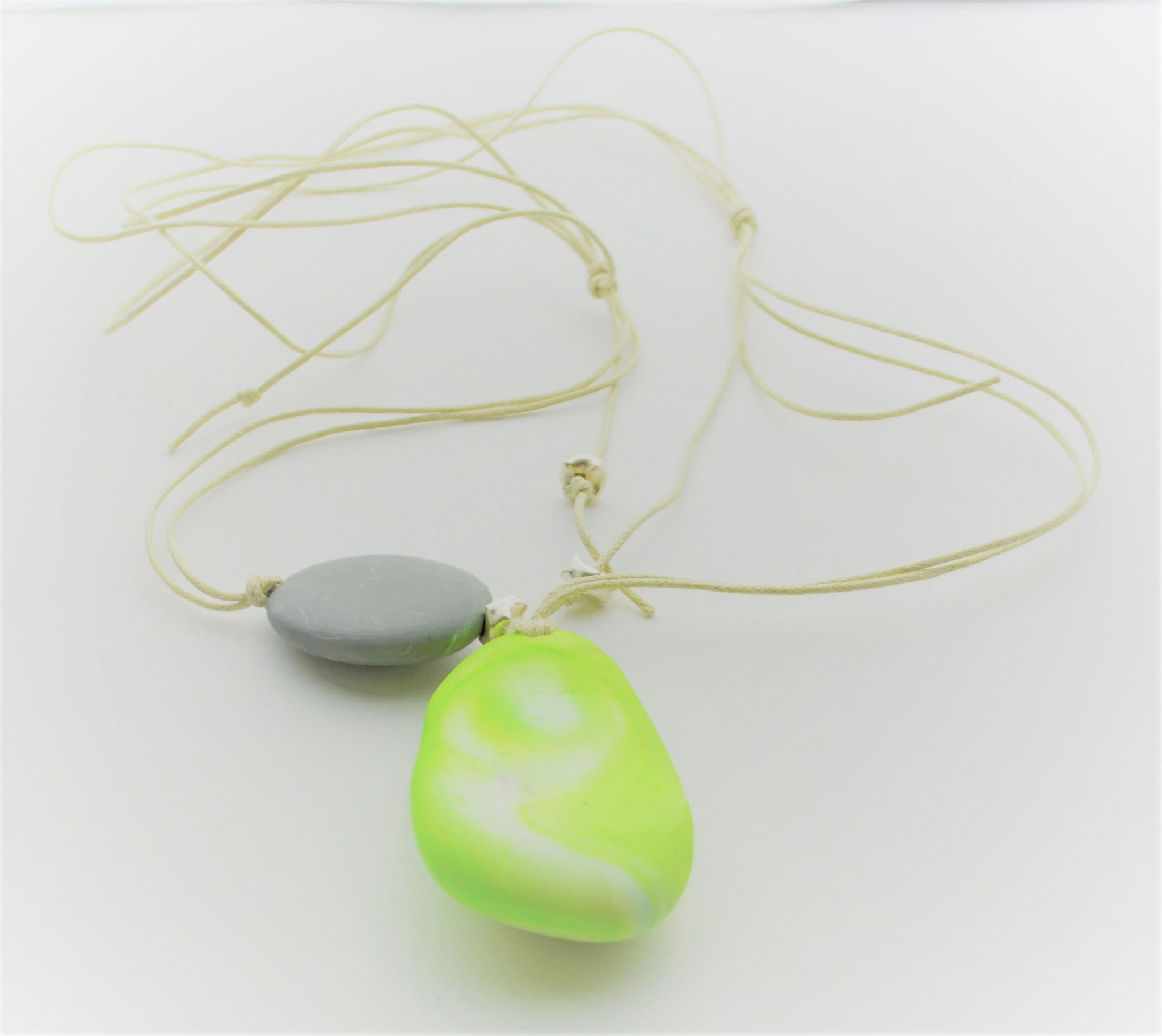 Contemporary handmade adjustable marbled lime green resin pendant