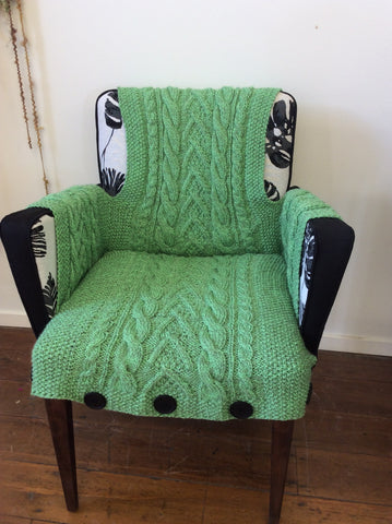 Black and cream chair with green Aran Cover