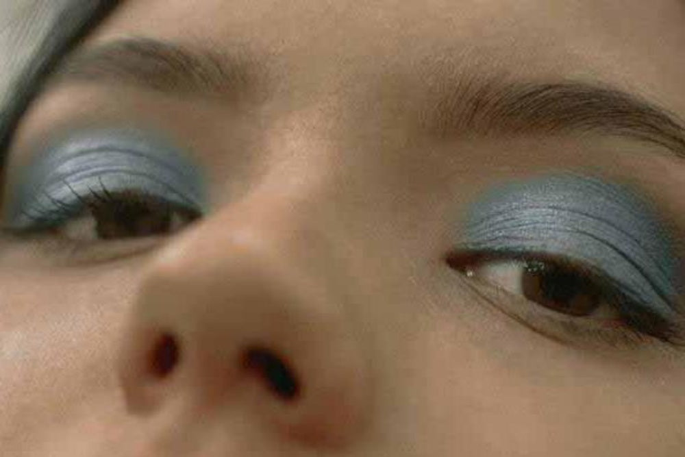 Girl with healthy skin and metallic light blue eyeshadow