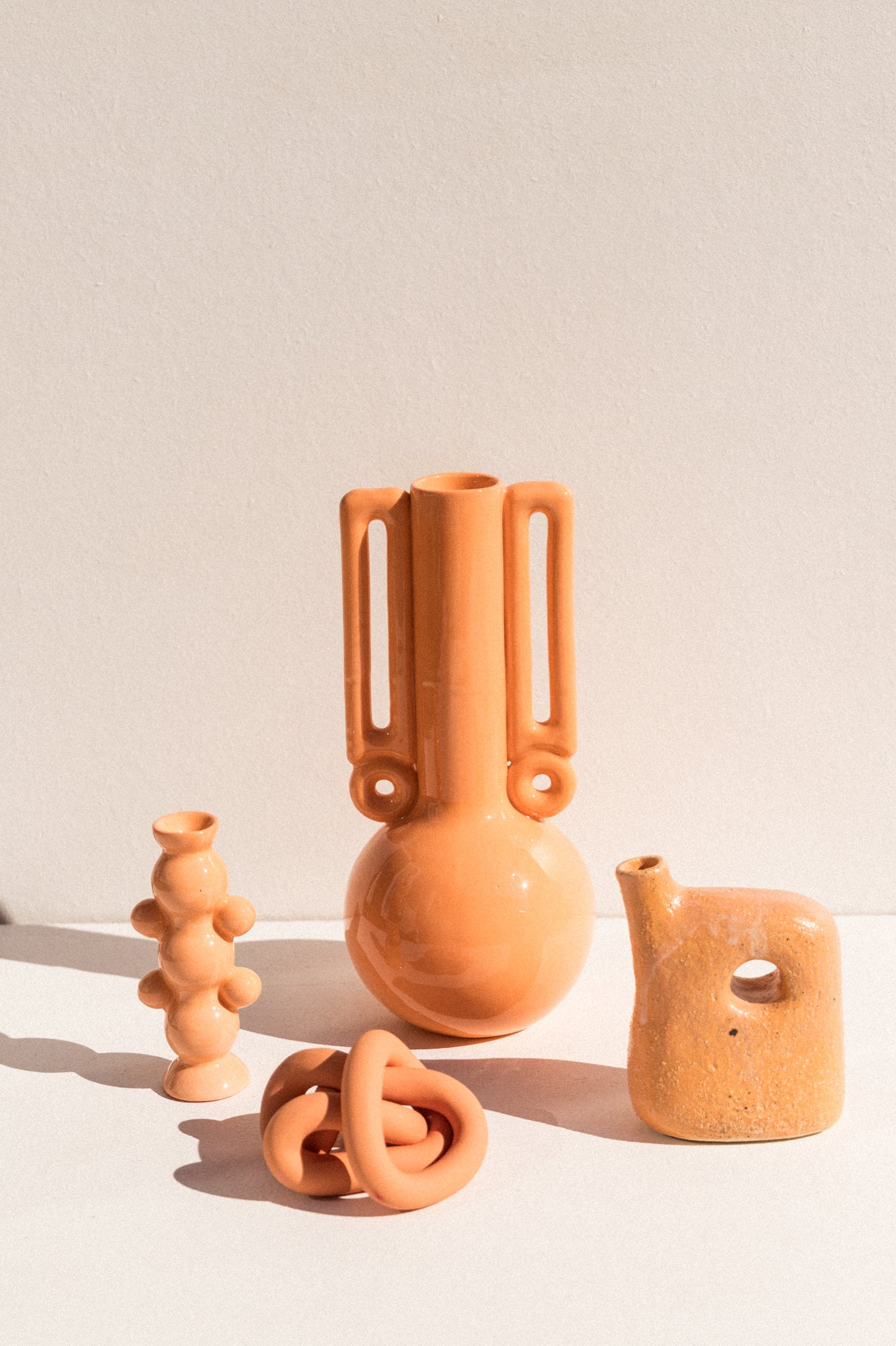 Colour therapy, Orange Vase and candle holder by Abs Objects, Deborah sweeney vase and Arowm jumbo ceramic knot on Makers' Mrkt Melbourne