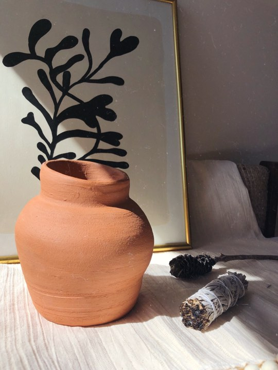 Terracotta vase, bundle of Sage for burning and painting with organic black shapes in the background