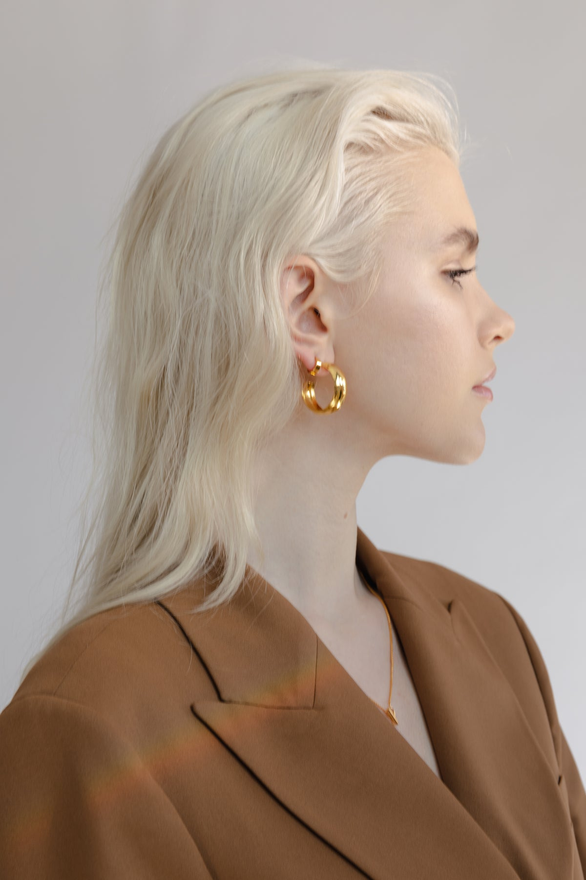 beautiful blonde model wearing tan blazer Flash jewellery Hollow Hoops in 18ct gold available on Maker's Mrkt Makers Market melbourne