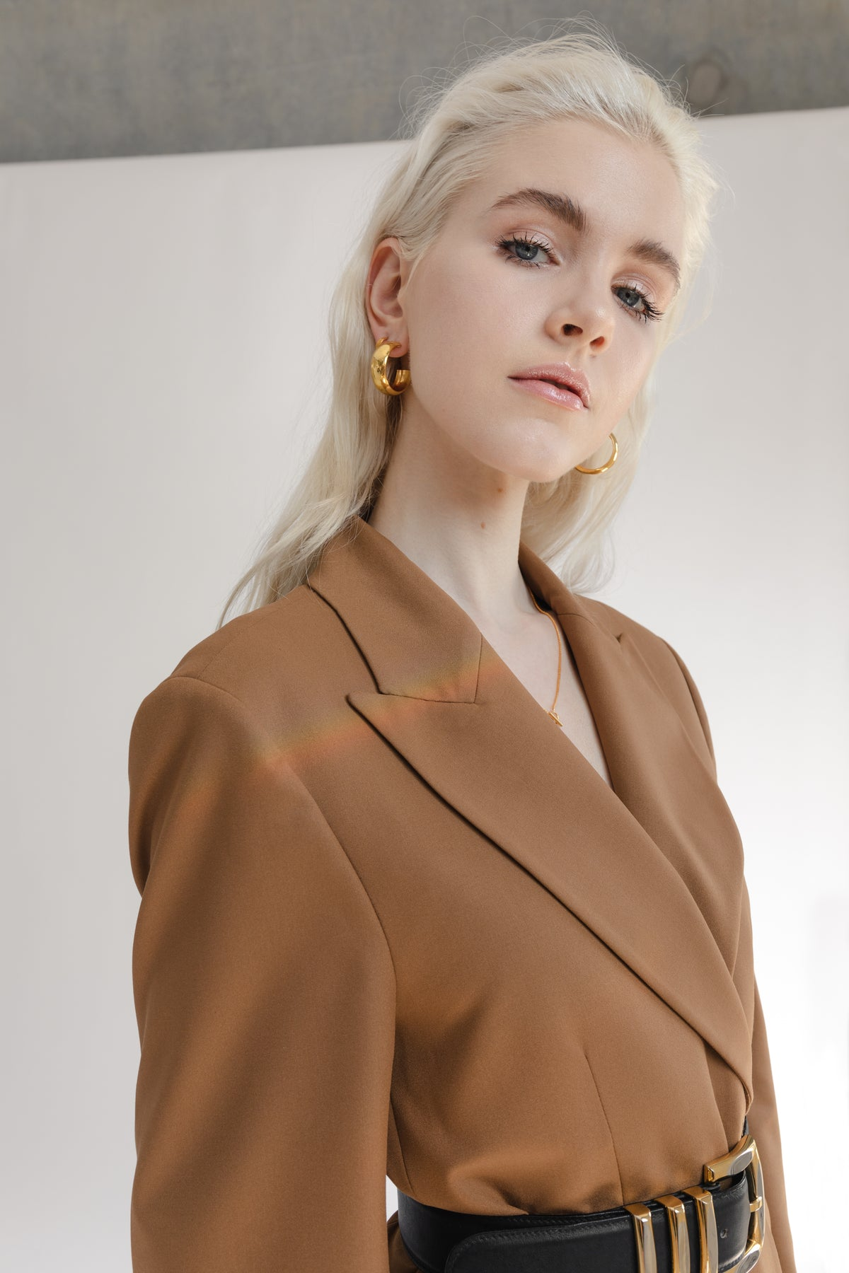 beautiful blonde model wearing Flash jewellery Hollow Hoops in 18ct gold available on Maker's Mrkt Makers Market melbourne