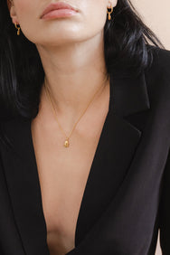 Model wearing Flash Jewellery gold Dune necklace pendant available form Maker's Mrkt Makers Market Melbourne