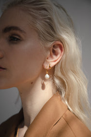 Blonde model wearing Flash jewellery Eva Pearl Sleeper Hoops with pearls in Gold. On Maker's mrkt, Maker's Mrkt Melbourne