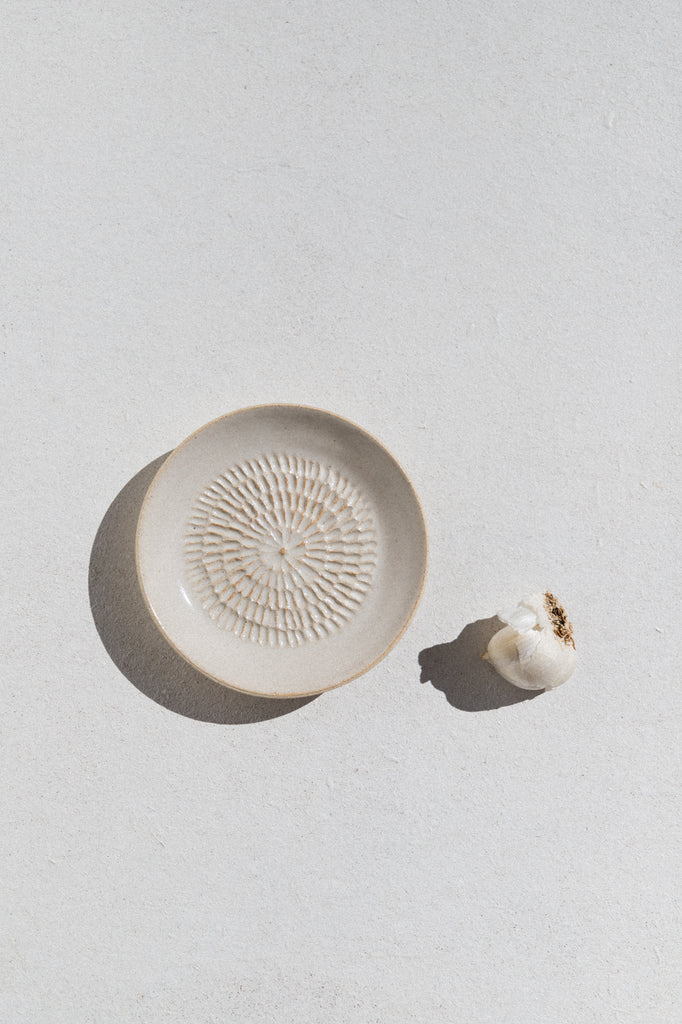 Kura studio ceramic garlic grater in ivory. From Maker's Mrkt Makers Market Melbourne