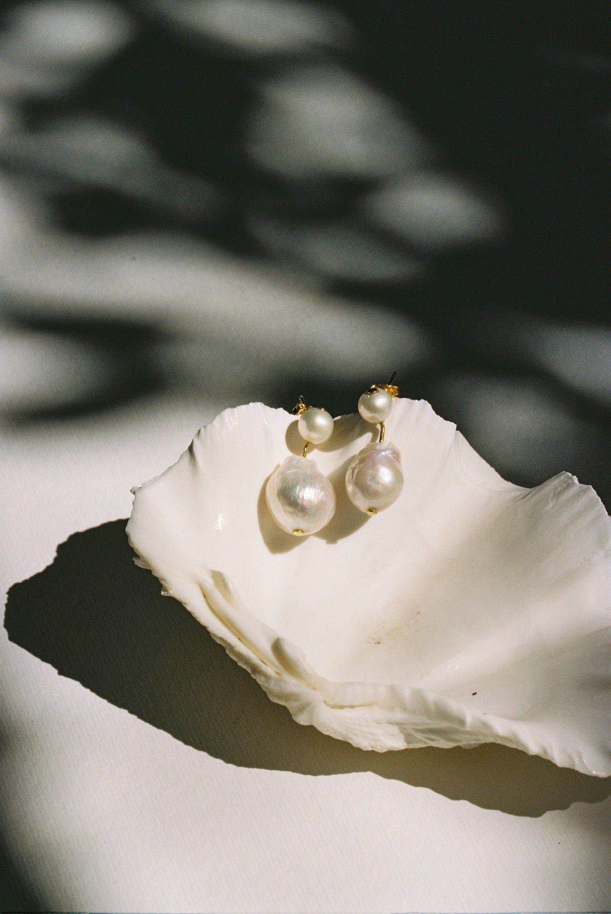 Pia Pearl earrings in gold on white background by Jasmin Sparrow. Makers Market Melbourne