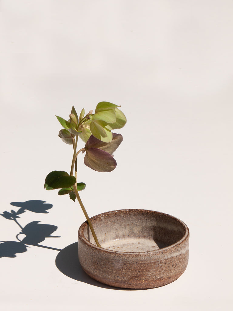 white Ikebana bowl with single stem flower by Asomibasu Clay Melbourne. Available on Maker's Mrkt Maker's Market