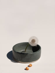green Ikebana ceramic bowl with single dandelion by Asobimasu Clay Melbourne Maker's Mrkt Makers Market