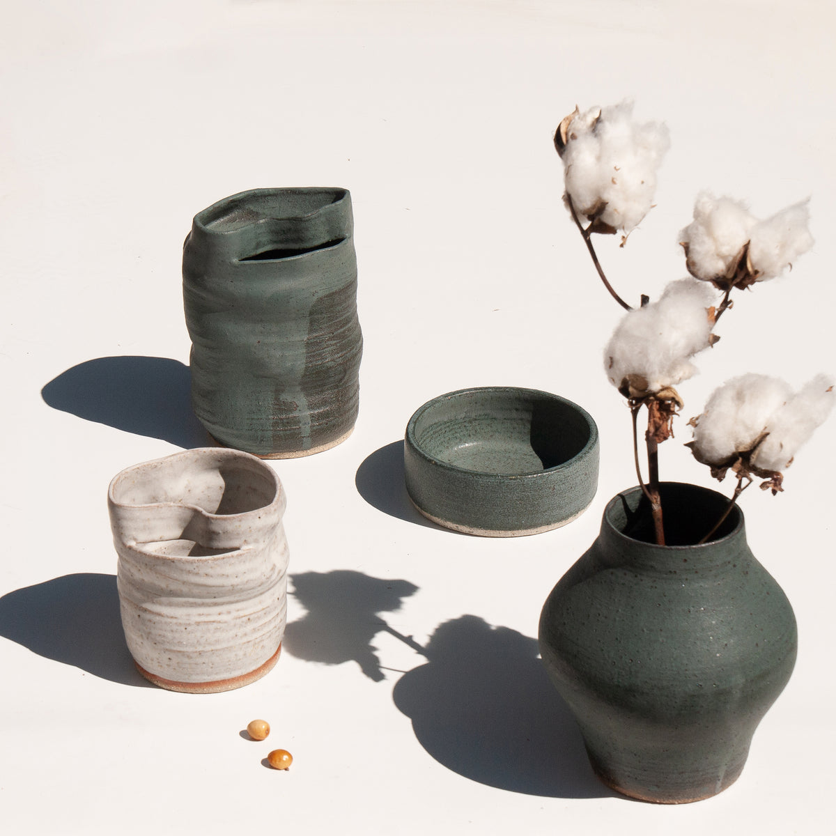 A selection of green and white hand-thrown vases with cotton by Asobimasu at Maker's Mrkt Makers Market Melbourne