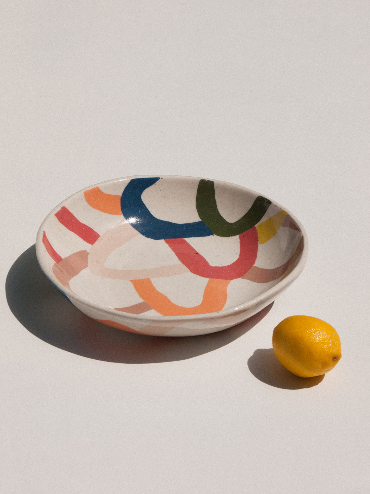 Wundaire stoneware plate in white with colourful irregular patterns. Maker's Mrkt Melbourne makers Market. Beautiful gift idea