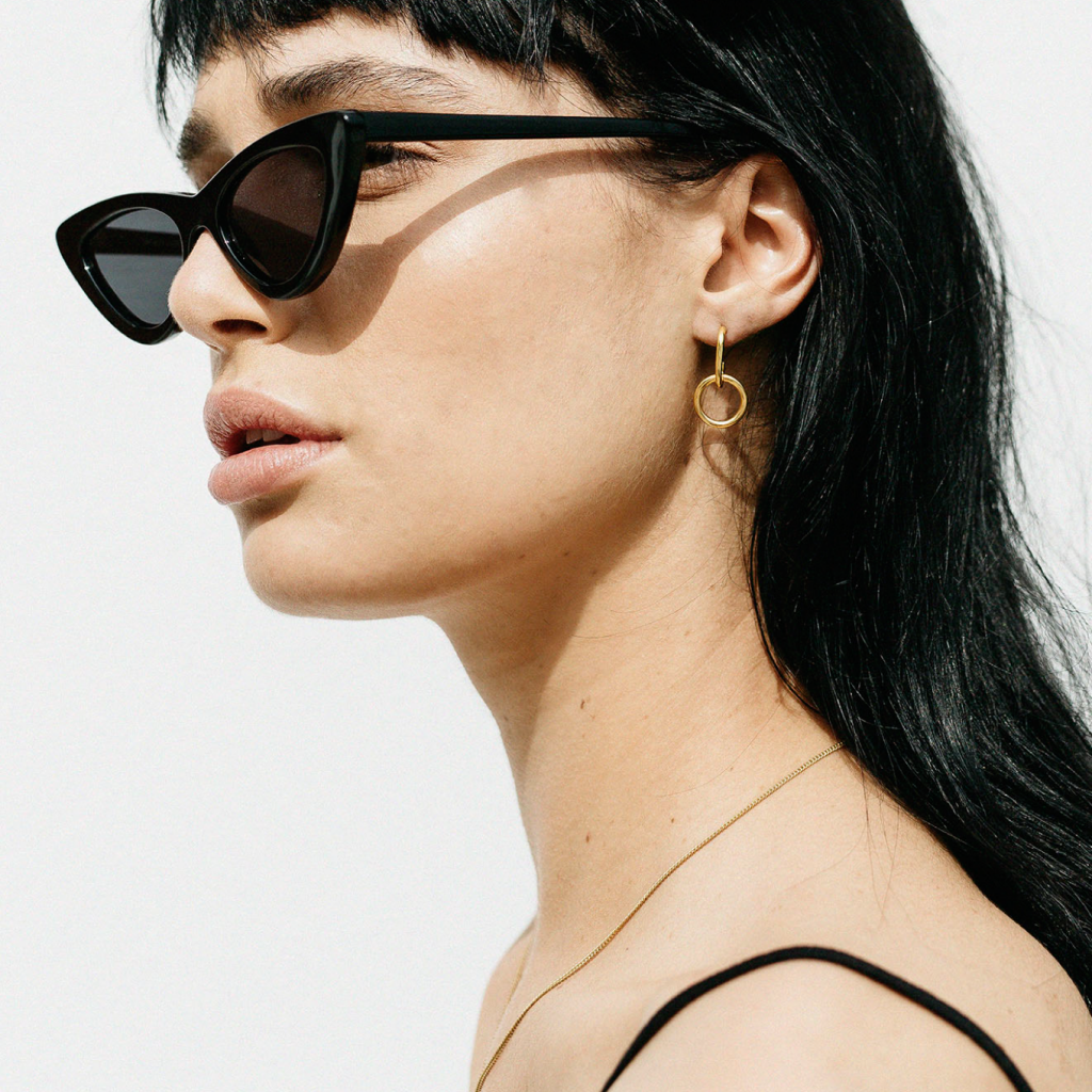 girl wearing black le specs and  gold plated brass hook hoop earrings by flash jewellery on Makers Market Melbourne Makers Mrkt