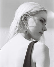 black and white photo of blonde model wearing Jasmin Sparrow Lulu Carnelian gold asymmetrical earrings from Maker's Mrkt Melbourne. Makers Market