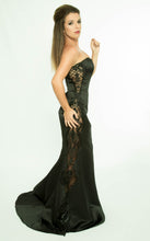 Strapless evening dress with transparent embroidered sides