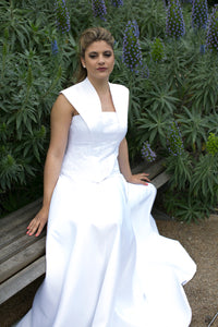 Smoking collar boned bodice, with lace applique and a line skirt with detachable tulle train